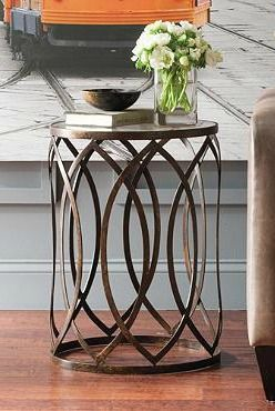 Featuring A A Light And Airy Cutout Design, The Garner Steel Barrel Accent  Table Is Sure