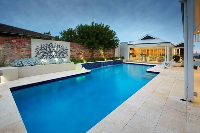 Designed by Outside In and constructed by LD TOTAL, this stunning home blurs the lines between indoor and outdoor spaces and maximises every aspect. With elegant stone work, classic waterwise plants and clever lighting around the pool to set off key features and complete the look.