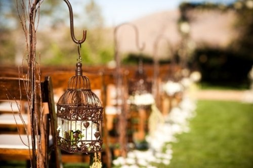 I really want to have lanterns lining my wedding runner, only my wedding is at night and they will be lit up.