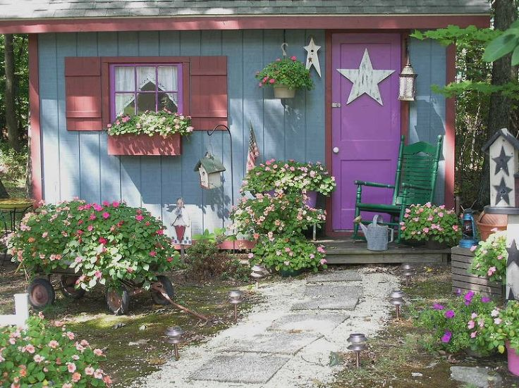 My fairy tale style shed- This is a 2 story shed built with the help of a friend a few years ago. It actually has a second floor loft that is accessible via a permanent ladder inside. It has double garage doors in the back with ramps so you can get a tractor in and out easily.
