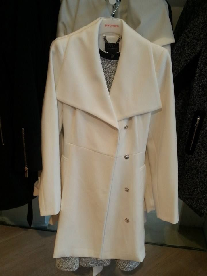 Vanilla trench with oversized collar. Great alternative to black or white over coats!