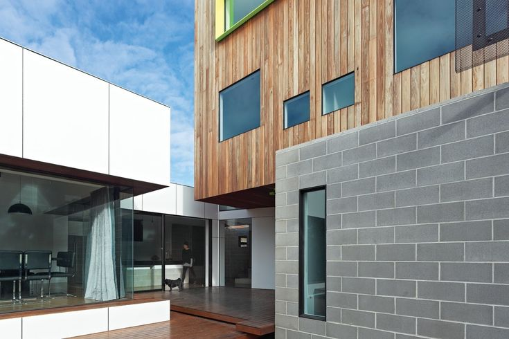 Besser block, black framed windows, timber cladding