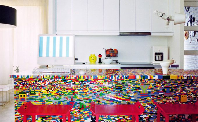 Parisian designers Simon Pillard and Philippe Rosetti, took a bold approach with their own kitchen by venturing to IKEA for the basic kitchen island and then spending the next week covering it with more than 20,000 pieces by another Scandinavian brand, Lego