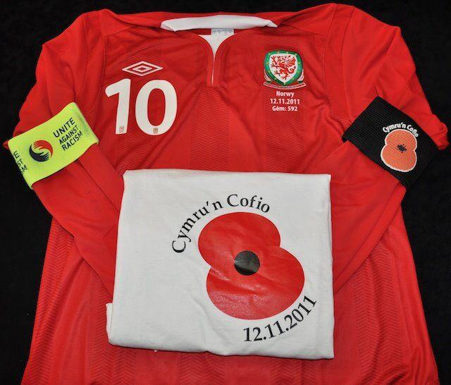 Aaron Ramsey Wales match worn shirt, warm up T-shirt, poppy memorial armband & captains armband v Norway 2012.