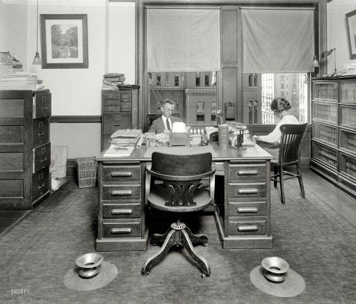 "Washington, D.C., circa 1923. ""Traffic World office."" Tobacco-friendly on both the left and the right. Harris & Ewing Collection glass negative."