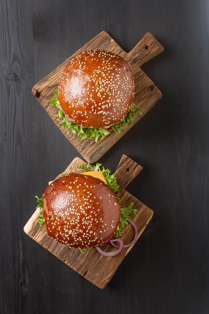 Closeup of home made beef burgers with lettuce and mayonnaise served on little…