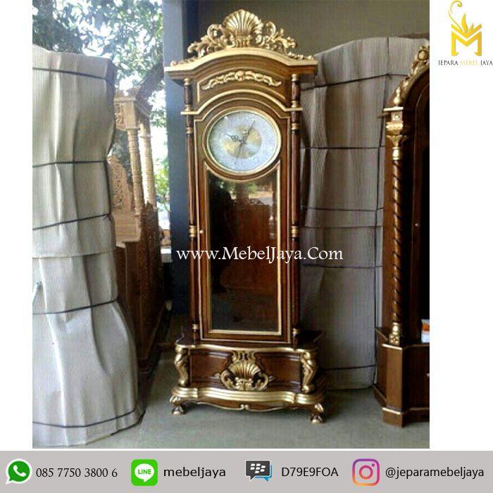 Jam Hias Mewah Ukir Jati Emas Terbaru - furniture almari jam bandul dengan ukiran emas mewah dibagian atas dan bawah di desain mewah dan kualitas terbaik.