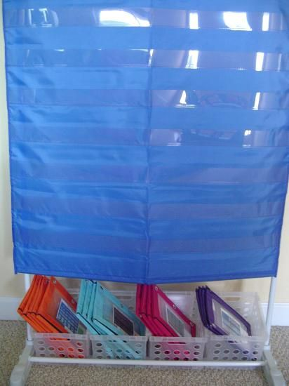 "Classroom Organization: pocket chart organization : ""The activities are stored in vinyl"