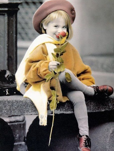 Kim Anderson is very famous child photographer.  Usually his photos are printed as greeting cards.