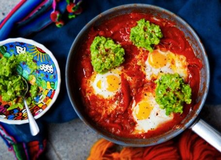Huevos Rancheros with Guacamole 1 medium onion 2 garlic cloves 1 tbs ghee or coconut oil 2 red peppers 2 cans tomatoes or 10 medium tomatoes approx. 800g 200ml water (2 dried bay leaves) 1 tsp smoked paprika 4 eggs a little cayenne or fresh red chilli to your taste ( 1 small handful of strong cheddar cheese) 1 large handful of fresh coriander ½ lime, sliced into 2 thick wedges