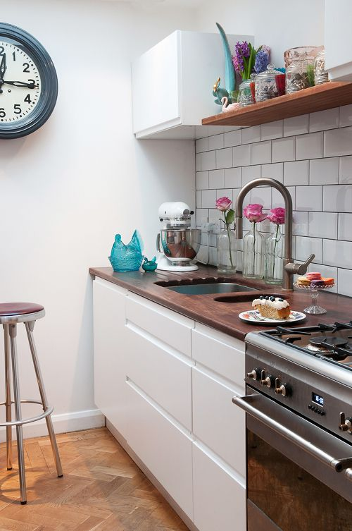 "Sneak Peek: A Colorful English Home. ""The kitchen is from Ikea with a Iroko worktop sourced from Trainspotters, the tiles are by Johnson's Tiles and all of our appliances are from Smeg."" #sneakpeek"