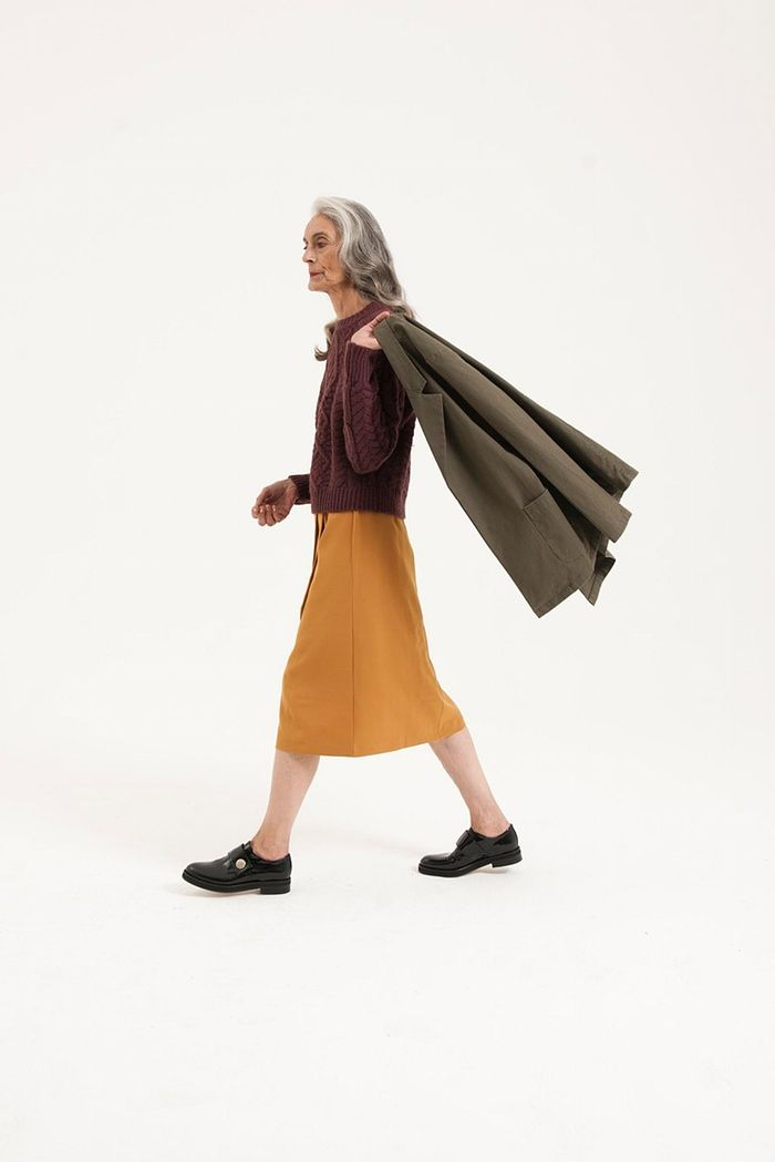 brown jumper, A-line yellow skirt, green jacket, black brogues