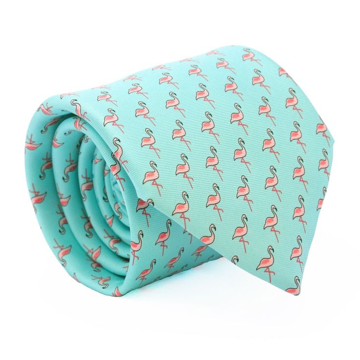 Our turquoise flamingo design silk tie is another classic REEF KNOTS double print with hammerhead sharks circling the tail!The design of this tie was inspired by our first pair of swim shorts and is also the first from our new 'Made in Italy' collection, using some of the finest silk tie craftsmen in the world. This tie is the perfect addition to the office, a wedding or makes a fantastic gift. Delivered in our signature gift box. Handmade inItalyTurquoisesilk tieScreen-printed silk…
