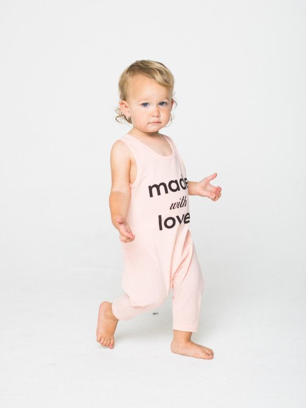 No Snap Playsuit with Made with Love print. Soft, stretchy and easy to put on and off for diaper changes. Preshrunk. Made in the beautiful USA. Parents' favorite!