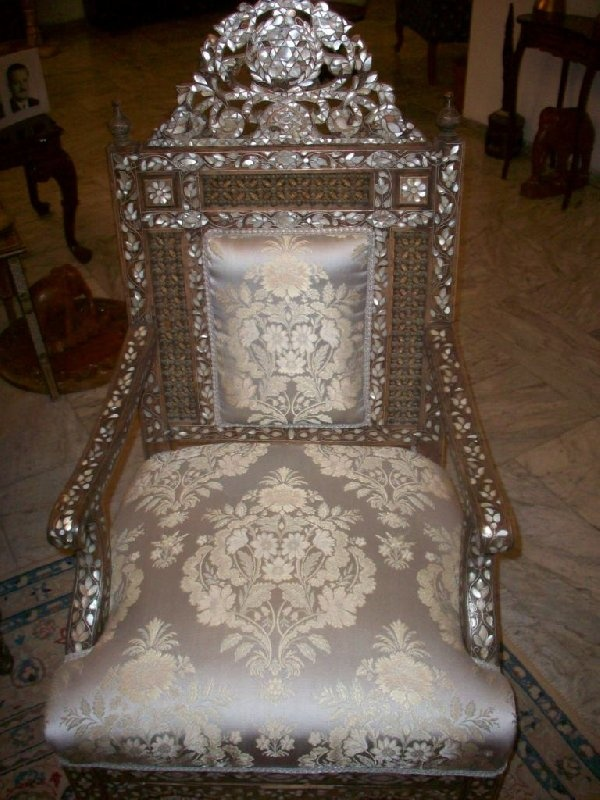Damask-covered chair inlaid with nacre mosaic.  Haifa, Israel.