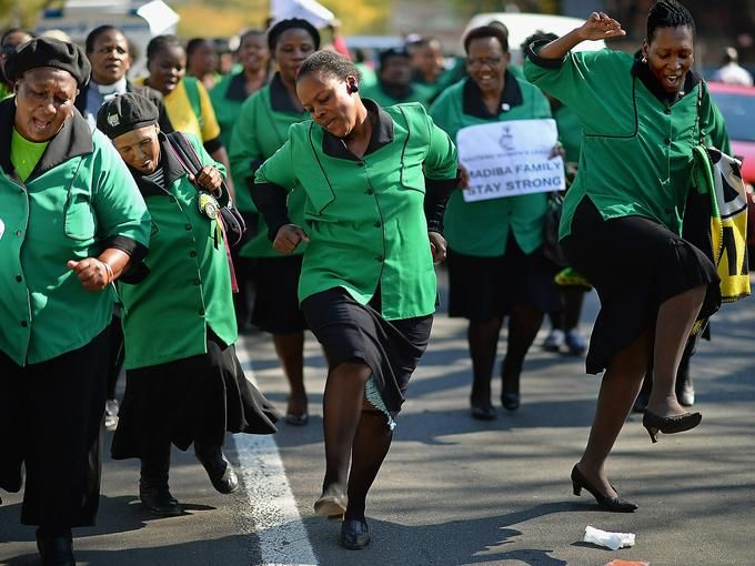Members of the African National Congress Women's League sing and pray outside the Mediclinic Heart Hospital.