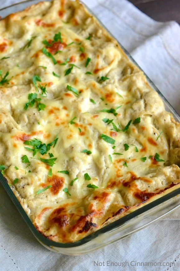Skinny Chicken Alfredo Lasagna - As delicious as the original, half the calories! | Find the recipe on NotEnoughCinnamon.com #healthy #casserole