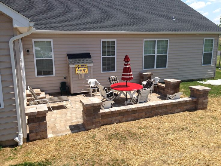 Hanover paver patio hardscape in 90 degree herringbone pattern featuring seating walls & columns with banding and steps designed & constructed by Ryan's Landscaping in Hanover, Pa.