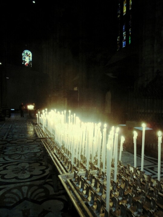 Candles. Interior view of the Duomo,  Milan