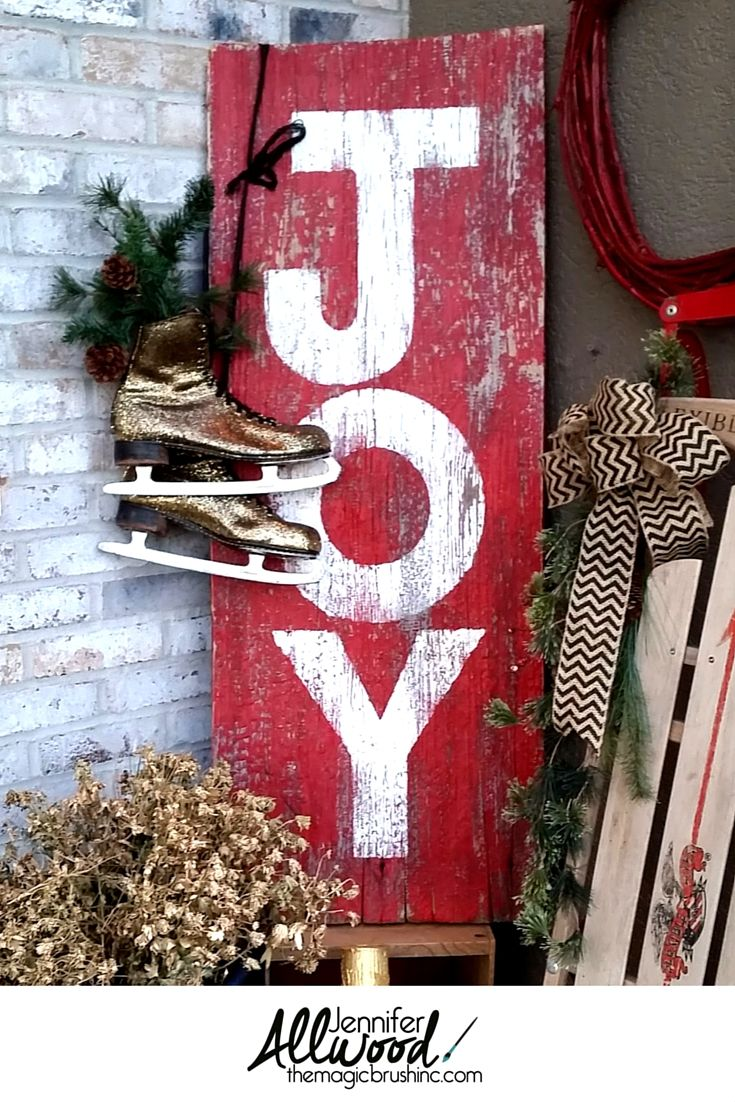 """A beautiful """"Joy"""" sign on repurposed barnwood. It's very easy, painted DIY project that makes for simple, poignant Christmas décor for your fireplace mantel. More painting tips at theMagicBrushinc.com"""