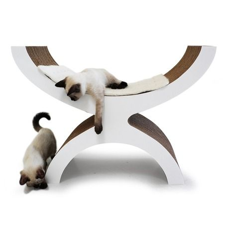 """""""The Couchette is a double-sided chaise longue providing both a sleeping environment as well as a hiding spot underneath. Multiple sides and angles for sharpening claws."""": ($320.00)"""