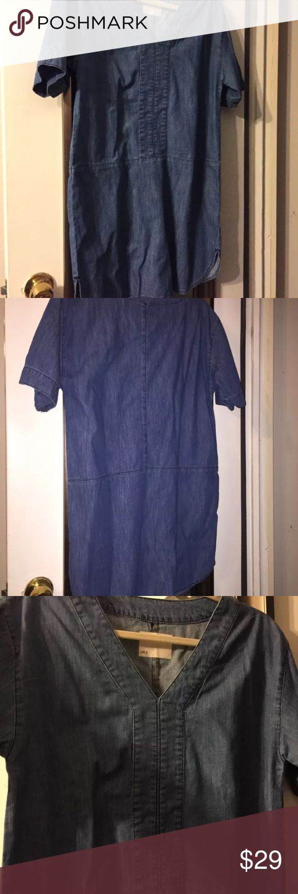 ASOS brand new denim shift dress. UK size 6 ASOS brand new denim shift dress. UK size 6  (They says it's like a US 2 but it's a very big 2 - roomy - wide very baggy fit, yet short in length)  The denim wash color is a medium to darker wash - it was hard to get it represented just right - the last photo best shows the color  I ordered this final sale and it was way too big but super cute and great quality ASOS Dresses Mini