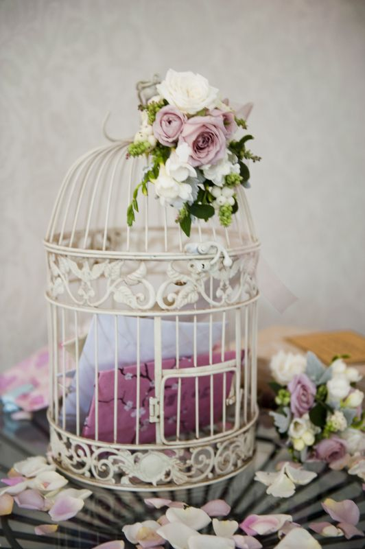 A Rose Decorated Cage For Cards Or Monetary Gifts