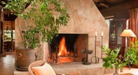 Awesome fireplace in a picturesque setting.
