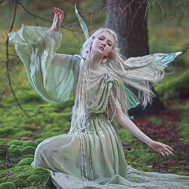 Photo, stylist, MUA, editor @agnieszka_lorek / model @mariaamanda_official dress @fairycave ✨ wings @fancyfairyangela ✨#agnieszkalorek #fairytale #fairy #elf #elves #ethereal #magic #fantasy #wings #rainbowcolors #dress #green #longhair #whitehair #naturalblond #crystals #ornaments #magic #forest #instalove #danishgirl #instacool #girl #romantic