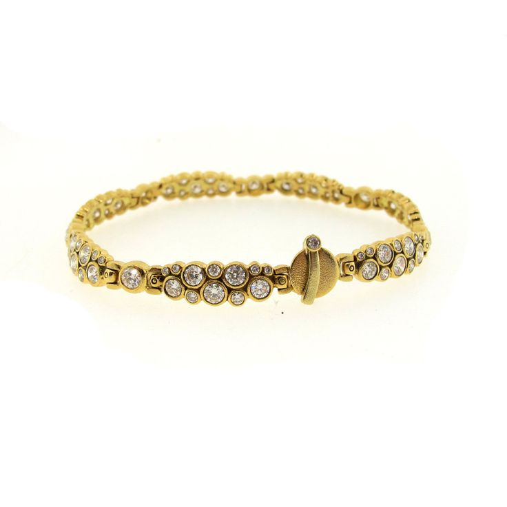 This unique take on a diamond bracelet features links of diamonds in a cluster design. The bracelet has a gorgeous artful look and is micro-hand hammered throughout with a unique circle bar clasp. B-5