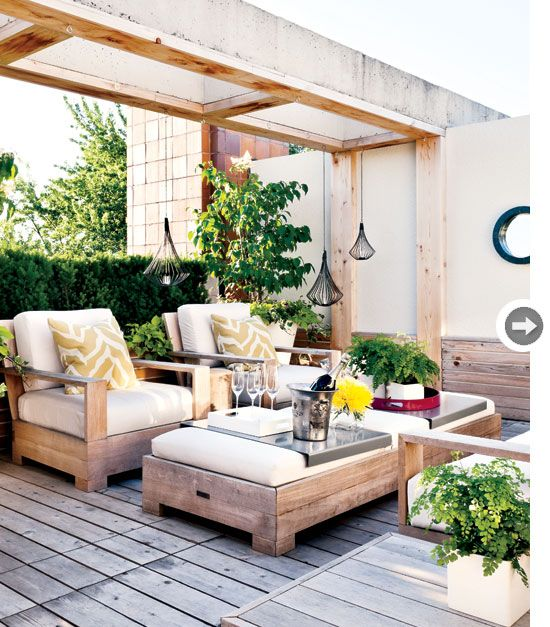 This modern outdoor lounge looks super cozy, could imagine drinking wayyy too much wine here.