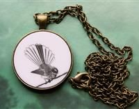 Fantail laser etched pendant. The fantail is a gorgeous small native bird with a fan tail!