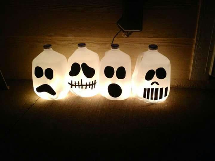 Milk jug ghost faces... Black sticker foam  White gallon milk jugs Stringed lights for glow effect.