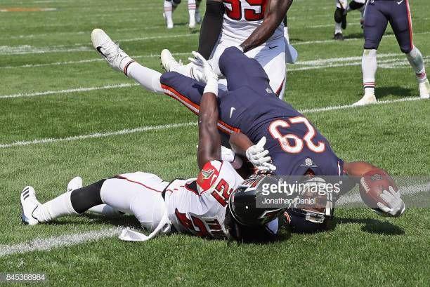 Tarik Cohen Of The Chicago Bears Falls Over Desmond Trufant Of The Chicago Bears Bear Chicago