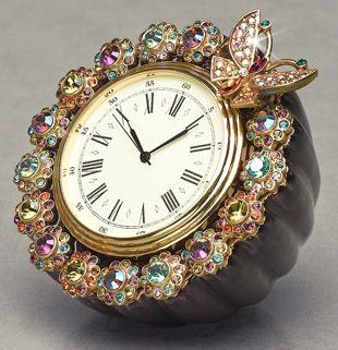 A butterfly, flowers & vibrant crystals surround this beautiful classic antique clock!