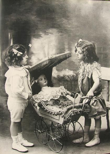Two little girls with a doll