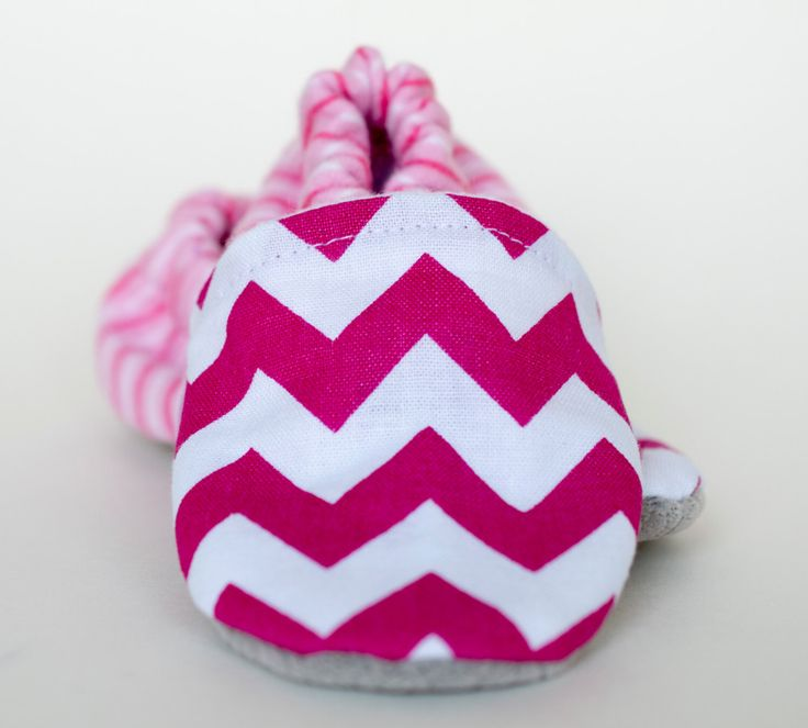 A personal favorite from my Etsy shop https://www.etsy.com/ca/listing/470636152/modern-baby-booties-fuchsia-chevron-pink