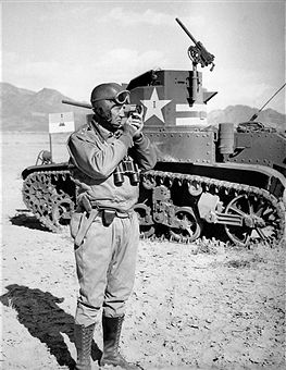 Major General George S. Patton, Jr., takes a sighting with a compass. He is standing next to a tank. North Africa, 1942. Pin by Paolo Marzioli