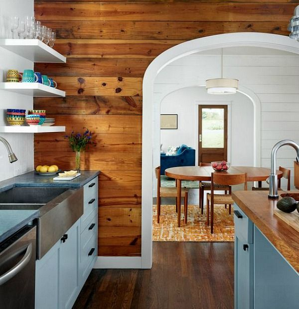 Beautifully updated kitchen in a small bungalow that exposed the original shiplap walls (Clayton & Little Architects in Austin, Texas).