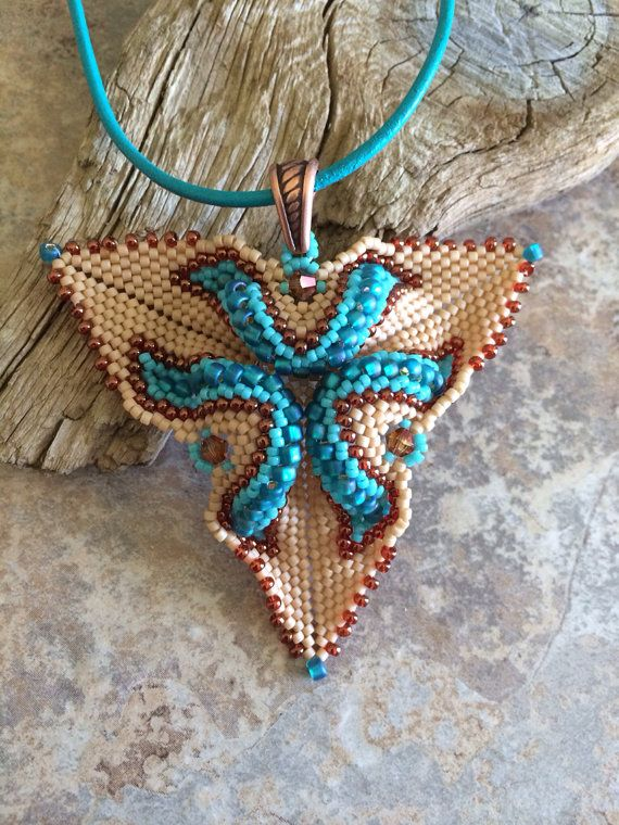 Oh, I like this in the Southwest colors! Southwestern Twisted Triangle Pendant on Etsy, $65.00