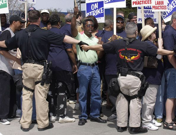United Auto Workers Union members protest the American Axle & Manufacturing annual Shareholder's Meeting at American Axle headquarters April 24, 2008 in Hamtramck, Michigan. The UAW went on strike against AAM eight weeks ago.