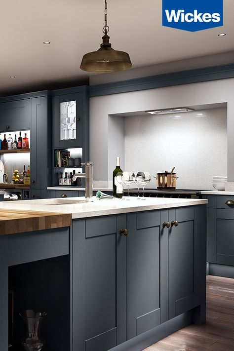 A DREAM KITCHEN FOR ENTERTAINING. The deep charcoal kitchen from Wickes is the ideal backdrop for entertaining in style.