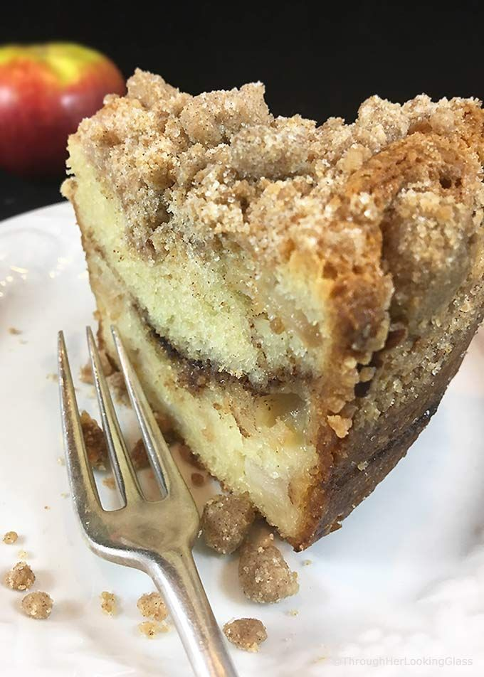 Tender Cinnamon Streusel Apple Coffee Cake: your new favorite sour cream coffee cake. Packed with apples, cinnamon filling & a crumbly cinnamon streusel.