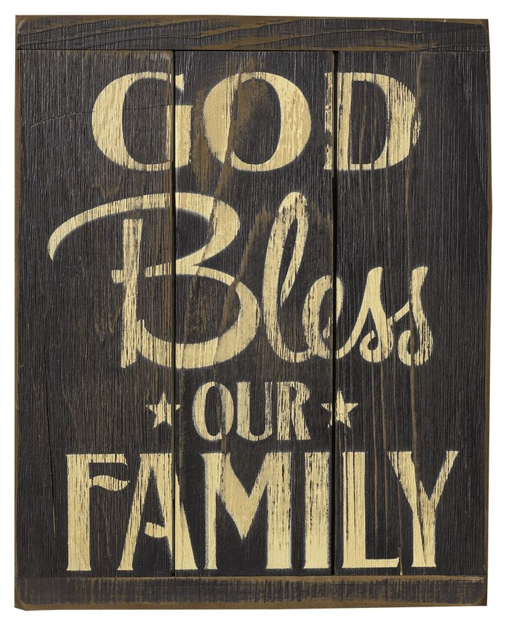 """The text """"God Bless Our Family"""" on a black background. This sign is made from rustic painted wood slats for a beautiful primitive look. A keyhole is in the back for easy hanging. The sign is 13 1/4"""" x"""