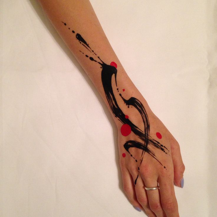 Abstract watercolor paint brush stroke tattoo on girl hand by Tim Mueller