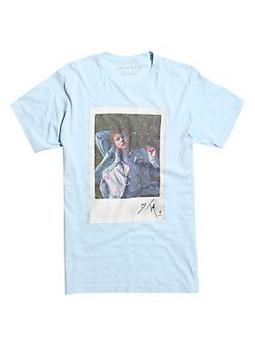 """Light blue T-shirt from Australian singer and songwriter Troye Sivan with a large instant photo style design of Troye lying in the grass.<br><ul><li style=""""list-style-position: inside !important; list-style-type: disc !important"""">100% cotton</li><li style=""""list-style-position: inside !important; list-style-type: disc !important"""">Wash cold; dry low</li><li style=""""list-style-position: inside !important; list-style-type: disc !important"""">Imported</li><li style=""""list-style-position: inside…"""
