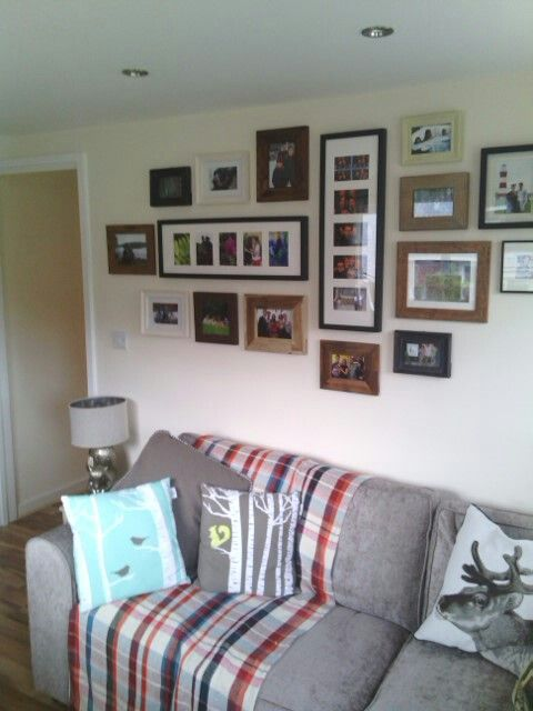New sofa and our photo frame wall