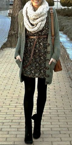 Patterned dark dress with belted waist, neutral oversized cardigan over dress, with chunky fall colored scarf. Finish with dark tights/leggings & dark boots.