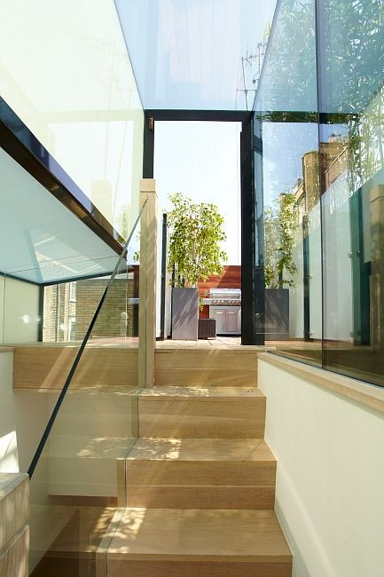 Bespoke staircase leading to roof terrace in a luxury home in London by property developers Landmass London