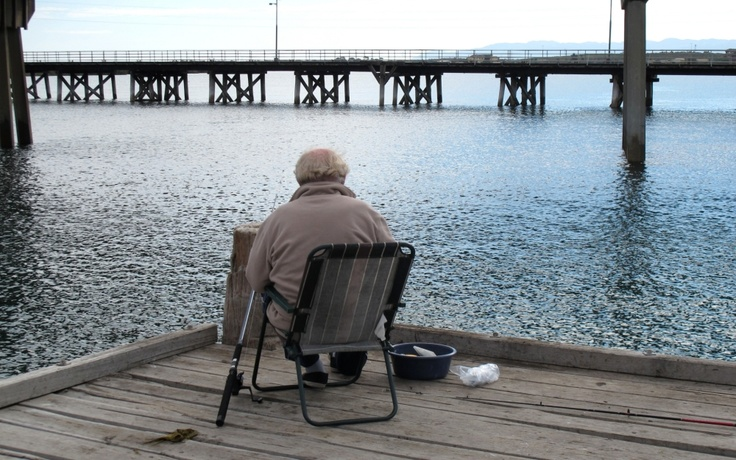 A bridge and a fisherman who may have been a statue, Port Augusta, South Australia.